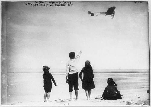 Children watching Louis Blériot leave Calais, France, in his airplane on August 3, 1909. From: The Library of Congress