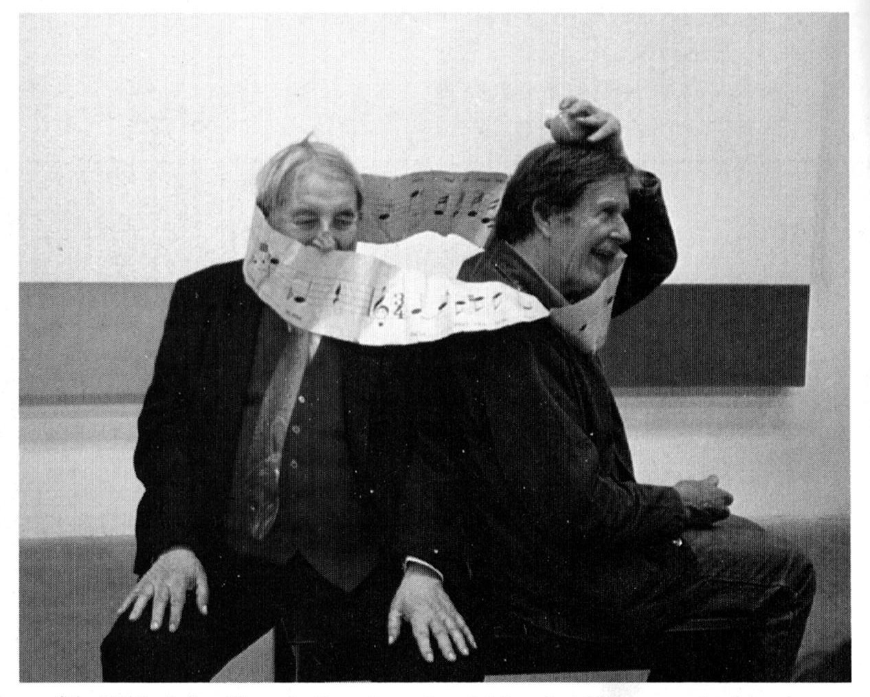 "Slonimsky and John Cage, Los Angeles 1987 ""enmeshed in the twisted musical ribbon"" of Slonimsky's invention called ""Mobius Strip Tease"". Photo by Margo Leavin"