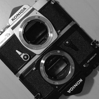 Konica T3 Silver & Konica T3 Black. The age-old camera war - silver Vs black. Grrr, fight. The winner here? Silver. Because the silver Konica has a split-prism focus screen, the black only a micro prism. Focus-tastic (needed for the 57mm f1.2 beast).