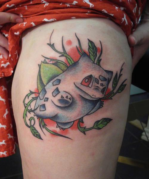 My Bulbasaur tattoo done at Elektrisk Tatovering in Odense, Denmark. It was made by Carlos, who's a really soft tattooer. It was the least painfull tattoo I have ever gotten. It is still a bit red and swollen, but hopefully the blue will be more clear when the redness is gone.