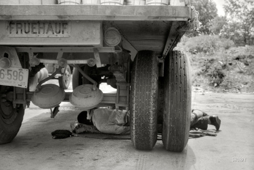 "via SHORPY: June 1940. Washington, D.C. ""Negro driver asleep under a truck. There are no sleeping accommodations for Negroes at this service station on U.S. 1."" Photo by Jack Delano for the Farm Security Administration."