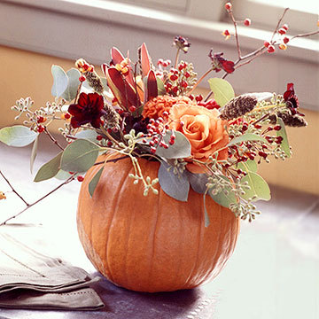 Turn a pumpkin into a vase for seasonal flowers, leaves, & berries!