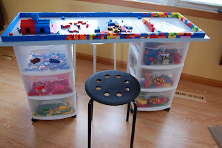 "Lego storage + Table : Our Wee Family Using plastic drawer cabinets, a four foot board and a few 15x15"" Lego building mats this mama made a fantastic Lego station. The table top is removable for floor play as well. Not pictured is a third drawer cabinet that its in the seating area."