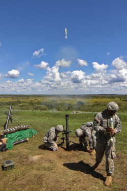 U.S. Army soldiers from 50th Brigade, 1st Battalion, 114th Infantry mortar platoon, New Jersey Army National Guard, fire 81mm mortars at Fort Drum, N.Y., during training on Aug. 19. The 1-114 IN has its headquarters in Woodbury, Gloucester County, N.J. Photo by Tech. Sgt. Matt Hecht
