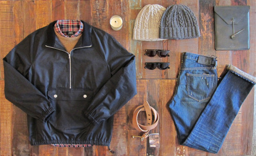 Fall's First Table treated cotton wind-cheater: APC wool sweater: Norse Projects plaid shirt: APC cable knit beanie: Palmer Trading Co. ipad case: Palmer Trading Co. natural belt: Tender Co. worker wash denim: Wings + Horns sunglasses: Lifetime Collective