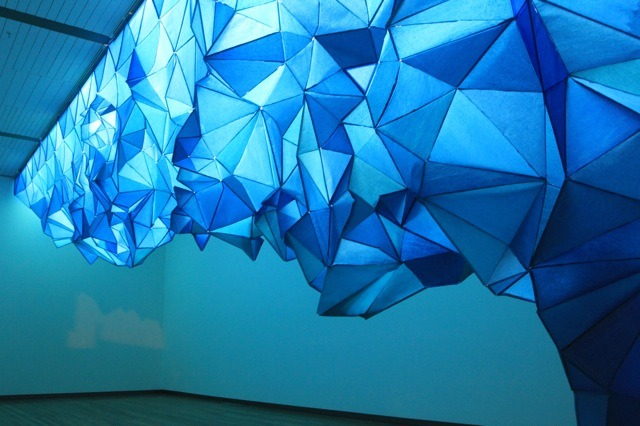 atavus:  Gabby O'Connor made these beautiful icebergs hanging the ceilings. This installation, What Lies Beneath, uses tissue paper and staples to construct these huge icebergs.  Via [My Modern Met]