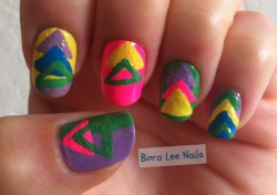80s-ish triangles! I love how this turned out, but then I went and decided to give my Essie: No Chips Ahead top coat another chance. I let it dry for 30 minutes, and it looked okay, but now here are bubbles in it this morning. There were no bubbles when I applied the top coat, and I didn't shake any of my polishes. What gives?!   As an experiment, I'm going to see how long this mani really lasts. No Chips Ahead? We shall see.