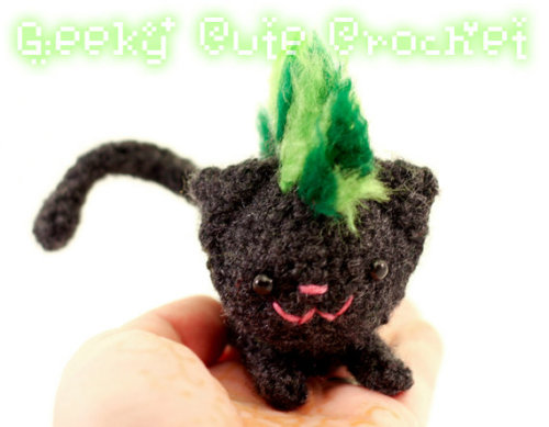 Kitty with a green mohawk!