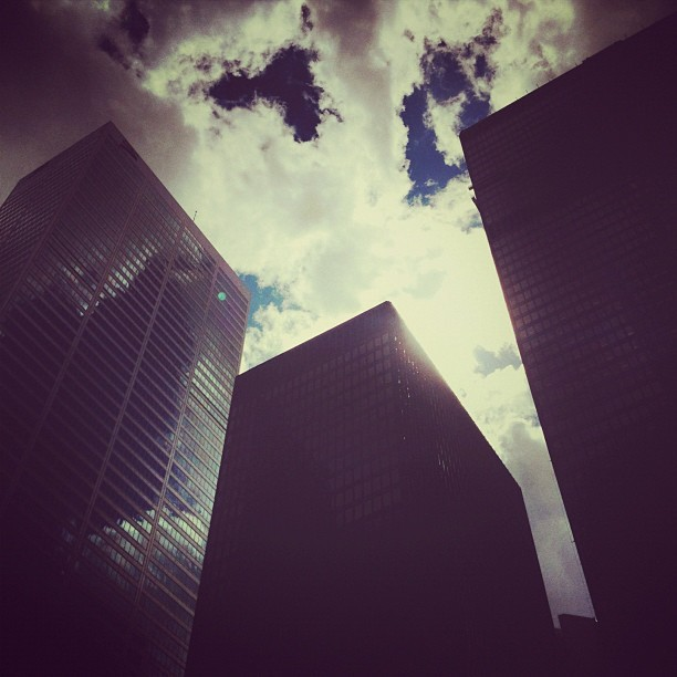 #sunset #clouds #sky #lookingup #buildings #downtown #financialdistrict #toronto #ontario #canada #igers #instagood #instamood #instagramhub #instadaily #instagram #ignation #iphone4s #snapseed #picfx #amaro #filter #justgoshoot #streetshot (Taken with Instagram)