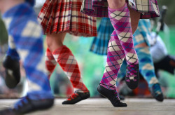 Highland dancers compete at the Braemar Highland Games in Braemar, Scotland.