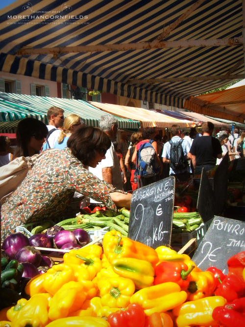 Open Air Market- Nice, France Taken ages ago when I still had only my hardy little Fujifilm point and shoot (who is still going strong after about eight years). I just adore the colors.