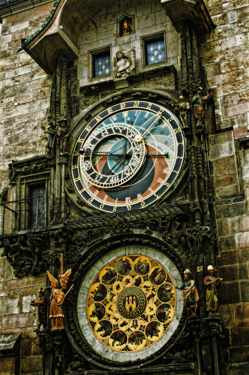 "cassandraclare:  The Staroměstský orloj! The old town square clock in Prague. I love this clock so much I put it into City of Lost Souls. The press of people was relieved when the street widened into an old medieval square. Despite the cold weather, it was filled with milling pedestrians and kiosks were selling sausages and hot, spiced cider. The three of them stopped for food and ate around a tall rickety table while the huge astronomical clock in the square's center began to chime the hour. Clanking machinery started up, and a circle of danc- ing wooden figures appeared from doors on either side of the clock—the twelve apostles, Sebastian explained as the figures whirled around and around. ""There's a legend,"" he said, leaning forward with his hands cupped around a mug of hot cider, ""that the king had the eyes of the clock maker put out after this clock was finished, so he could never build anything as beautiful again.""  Astronomical Clock. Old Times Square, Prague"