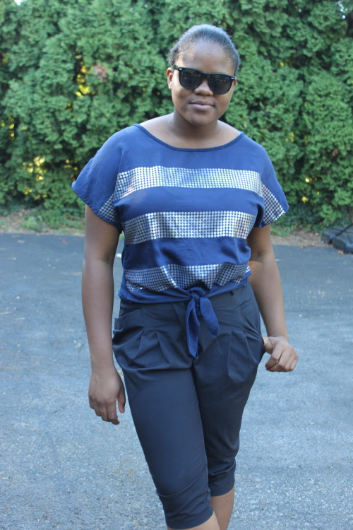 Be Cool! That's not hard to do in a  box-tie hem blouse, harem capris, and black sunnies. Tolu O. - Portland, Oregon