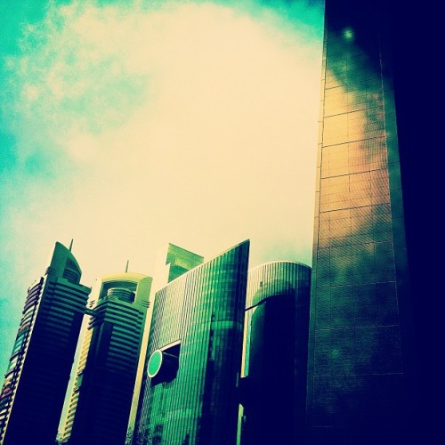marwanalsharif:  An architecture flare; downtown boulevard. The summery ice cold Starbucks latte; the ticking paper works. We were reflecting to the sound of open hued tones. (Taken with Instagram)