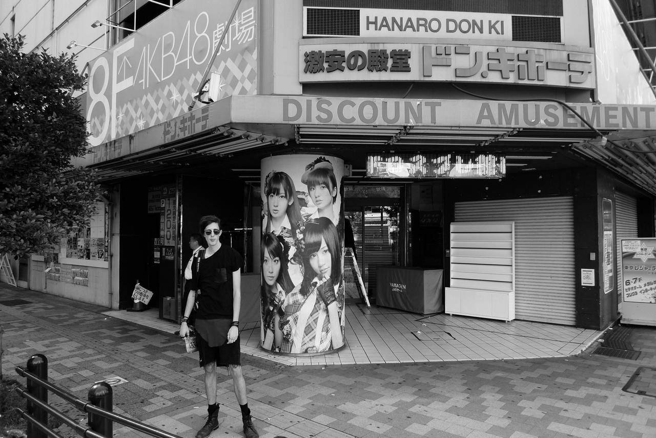 Japan Day 2: Akiba Me in front of a large AKB48 advertisementWearing:DIY tabard shredded Levis denimRecycled leather and tire bootsNicholas and Mark tank topT shirt with leather pocket detail  Taken by my friend and fellow traveller over at Dit-Rien