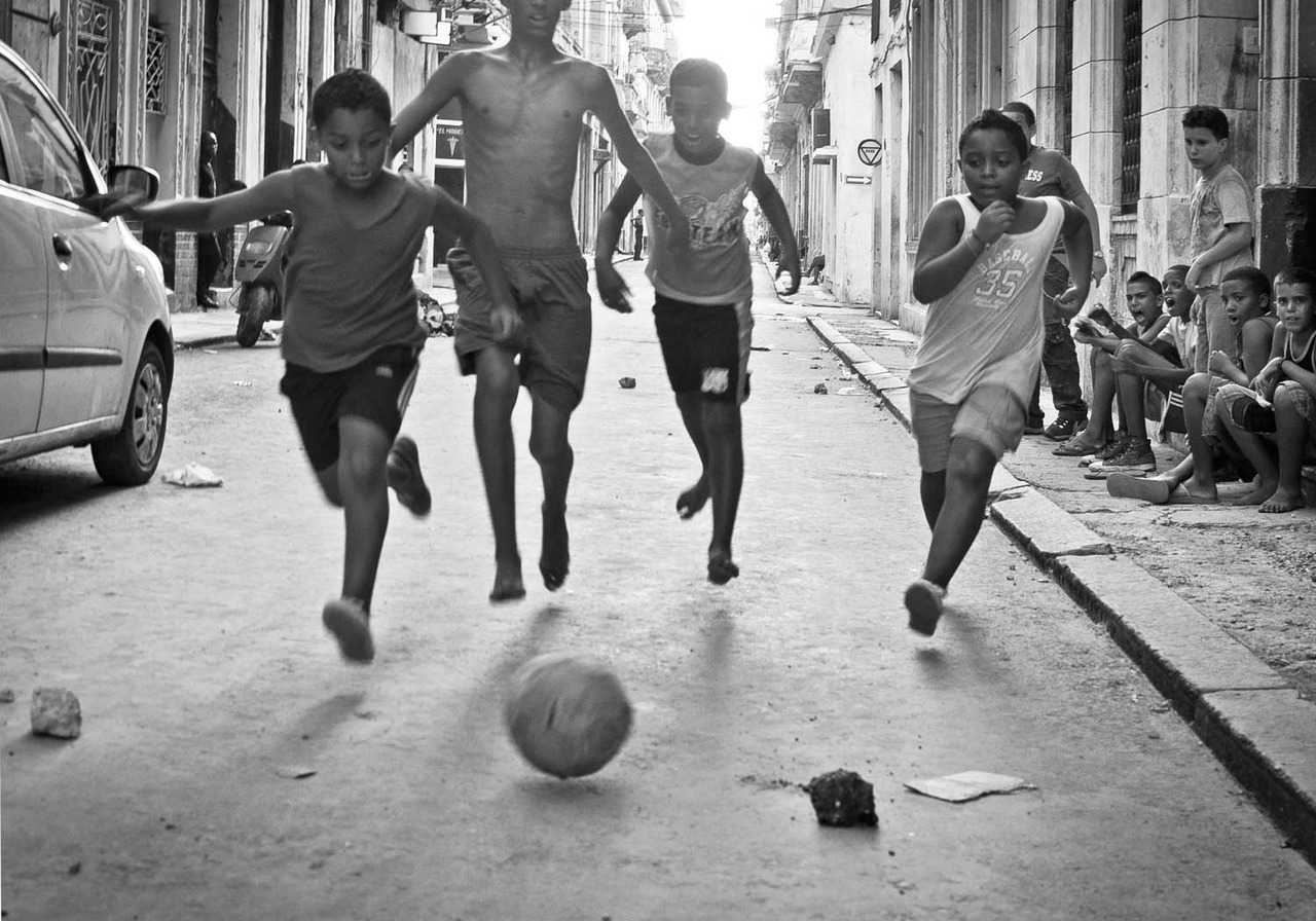 Street football, Vedado, Havana (2010) From this exhibition of photographs of Cuban life by Ben McGee