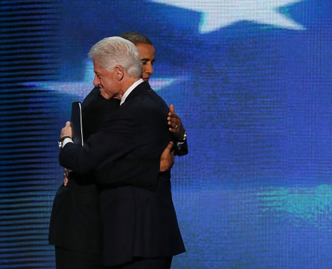 "newyorker:  Clinton's Speech: The Power of a Hug  …it was exactly their lack of personal chemistry and failure to become ""close friends"" that gave Clinton's speech its lift. A subtext of the address was that, just like Bill Clinton, wavering voters need not love Obama to understand that he's a better choice than Romney. When the two Presidents came together and hugged after the speech was (finally) over, the distance between them made their embrace all the more powerful.  Ryan Lizza on Bill Clinton's speech in support of President Obama at the Democratic National Convention in Charlotte last night: http://nyr.kr/RbCIoj  Photograph by Alex Wong/Getty Images.   I think this is a pretty awesome duo."