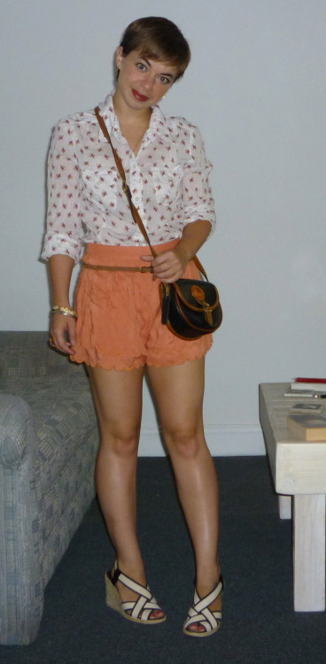 Blouse: Lucky via the Goodwill $14, Scalloped Shorts: Modcloth on sale for $16, Espadrilles: Macy's purchased with gift card, Belt: JCrew purchased with gift card, Bag: childhood gift from my great-aunt!, Bracelets: vintage via my mom, Ring: Banana Republic previously owned for 4 years I'm toying with the idea of adopting a really dark lipstick for fall. The one in the picture above is the darkest shade that I've got, Berry Freeze from Clinique.  But I'm talking REALLY dark.  Like the NARS shade that Jo Anne from Cup of Jo is wearing here.  I know that it's pretty bold, but I've already chopped off all my hair so I should go full on. Don't you think? Total cost of the outfit = $30 (MAGIC NUMBER!!!) Remaining budget for 2012 = $558 Follow the $30 Project on Twitter, Pinterest, and Instagram.