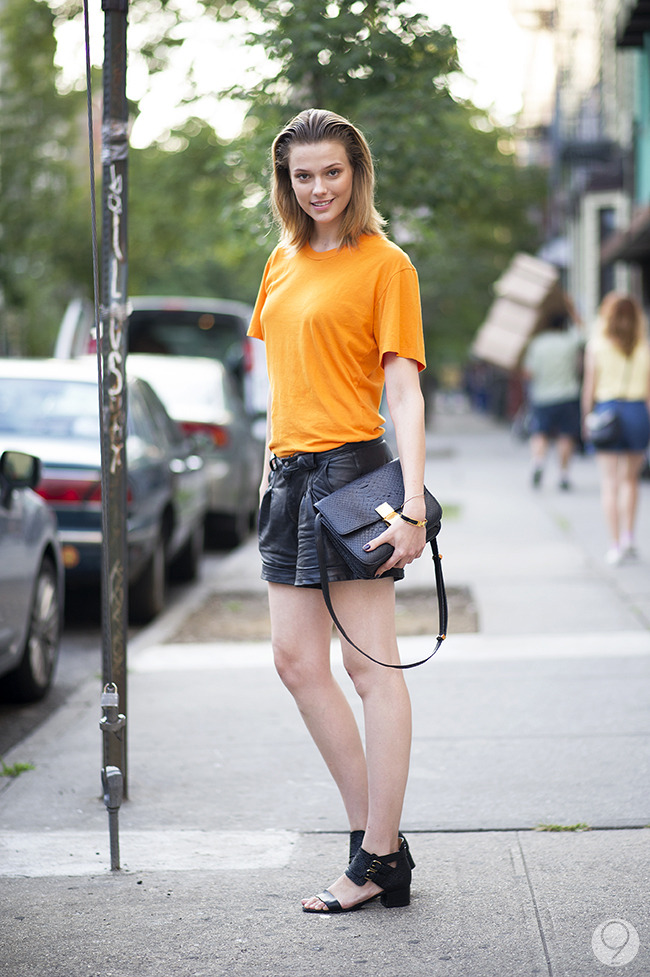 Street Style: Martha Streck amps up a t-shirt with leather shorts and accessories. Via I'm Koo.