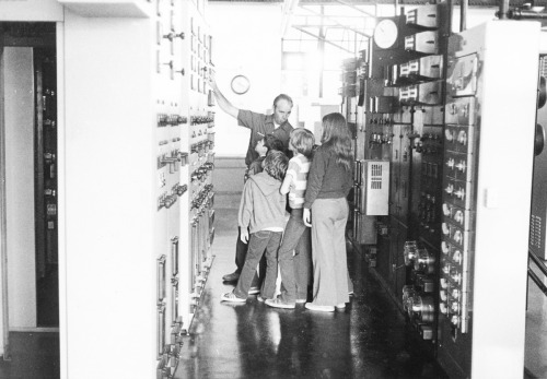 "Students Tour Amoskeag (c. 1970s) Who doesn't want to learn how a power plant works? Here, hydro employee Frank Bellefeuille is pointing out the instrumentation and controls at Amoskeag Hydro Station. The 17.5 MW renewable plant—located in Manchester's millyard—continues to be a popular destination for students today. 2012-09-07: Thanks to Mark and Wendy Vattes for updating us with the employee's name. According to Mark, ""My Dad, John Vattes, a PSNH retiree, confirmed that the PSNH employee pictured in the photograph is Joseph Francis ""Frank"" Bellefeuille. My Dad worked at the Amoskeag Hydro in the 1960s and early 1970s with Frank, who is also my Mom's uncle."""
