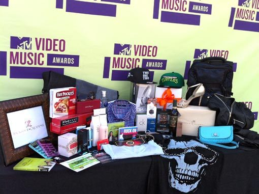 entertainmentweekly:  Here are the contents of the gift bag MTV is bestowing on celebrities at this year's VMAs. Among the highlights: - Hot pockets. Hot pockets. - Condoms, because obviously. - Bracelets made of guitar strings - Official Teenage Mutant Ninja Turtles snapback hats. Jealous!  Ciroc, that shirt, bracelets made of guitar strings…