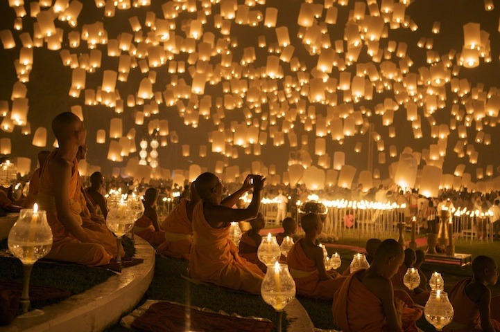 mydarkenedeyes:  Stunning photos of Chiang Mai's Floating Lantern Festival. Thousands of people gather and launch hot-air lanterns into the night sky. They are made of a thin fabric - usually rice paper. A candle or fuel cell is attached so that when it's lit, the hot air trapped inside creates enough lift for it to float away. It's a spectacular sight as thousands of lanterns are released at the same time. The festival is a time to pay respect to higher deities - you say a prayer, make a wish and then watch as your lantern floats away. Many people also believe that the lantern will carry your troubles away with it. Via My Modern Met (Click for more info and photo credits).  Prayers