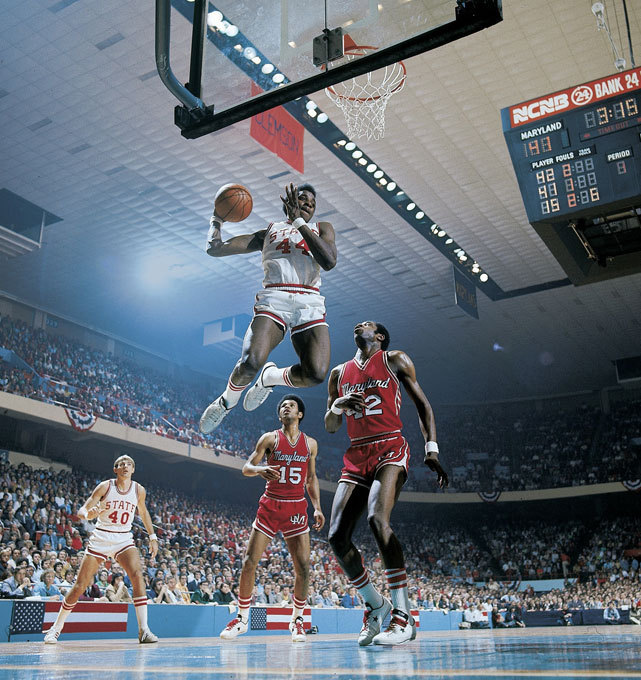 North Carolina State's David Thompson grabs a rebound during a 1974 NCAA Tournament game against Maryland. Thompson would be named the tournament's Most Outstanding Player after leading the Wolfpack to its first national championship. (John D. Hanlon/SI) WOLFF: College Basketball's All-Time Thrill List