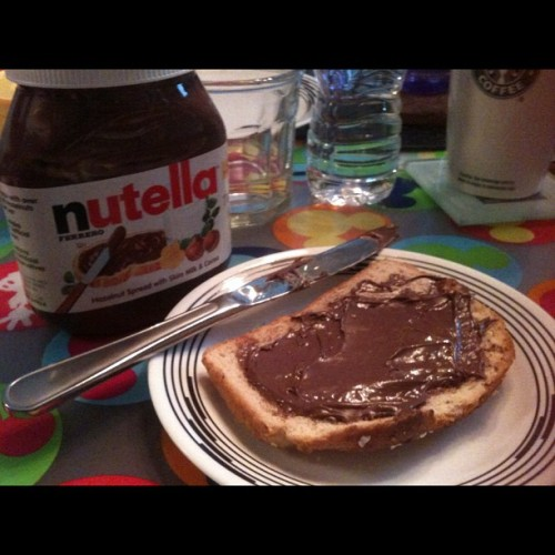 Snacking on nutella and whole grain oatnut bread coz I don't have pandesal. 😢evil people @fudgetastic @k_aint_no_saint @cattbuena @euvespa 😝 (Taken with Instagram)