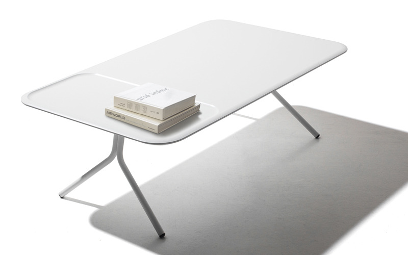 Scallop is a minimalist design collection created by Switzerland-based designer Samuel Wilkinson for Versus. The inspiration for the design came from observation of objects grouped on a low table. Each of the variations within the collection include a recessed area for framing frequently used items such as remotes, magazines, vases, etc.
