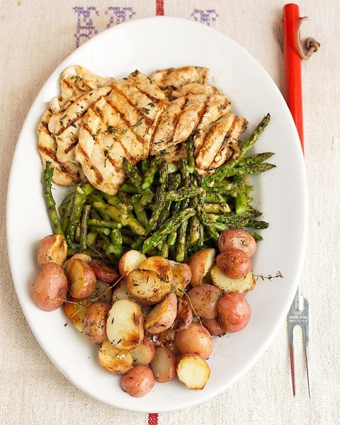 Garlic marinated chicken with grilled potatoes and asparagus by martha stewart. This is definitely a platter for a party! So much food!