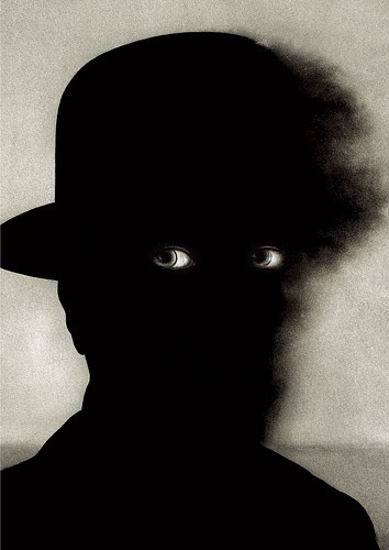 Eyes and silhouette of man wearing hatWieslaw Rosocha