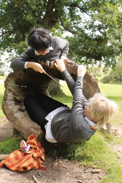 Here have a photo of me and a friend cosplaying as Marauders era Remus and James :D