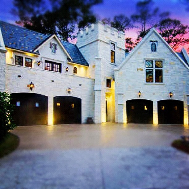 Outstanding curb appeal! #castle #garage #curbappeal #money #marble #design #architecture #luxury #rich #wealth #sunset #cool #swag #style  (Taken with Instagram)