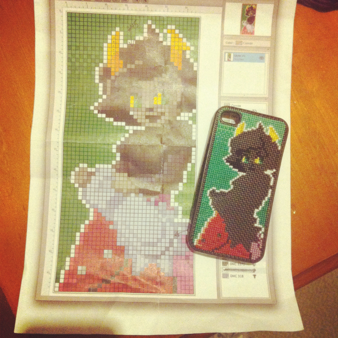 I was home sick yesterday, so I made some progress on my Kanaya iPhone case.  Although today I wish I'd cross-stitched less enthusiastically: my fingers are sore!