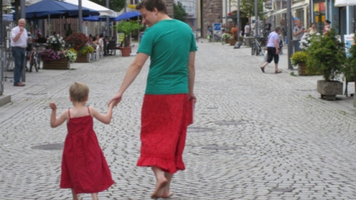"bulletinaweave:  ""My five year old son likes to wear dresses,"" says German dad Nils Pickert. Back when he lived in West Berlin, it was certainly a conversation-starter, but not much more than that. Now, however, Pickert and his son live in a ""very traditional"" South German village where his son's predilection for dresses is the talk of the town. ""I didn't want to talk my son into not wearing dresses and skirts,"" Pickert tells the German feminist magazine EMMA. ""He didn't make friends in doing that in Berlin already and after a lot of contemplation I had only one option left: To broaden my shoulders for my little buddy and dress in a skirt myself."" At first, Pickert's son was reluctant to wear a dress in public, fearing he would be laughed at, particularly by other kids at his preschool. But that all changed one ""skirt and dress day"" when he and his dad made a resident of the town stare so hard she slammed into street light face first. ""My son was roaring with laughter,"" says Pickert. ""And the next day he fished out a dress from the depth of his wardrobe. At first only for the weekend. Later also for nursery-school."" As you might imagine, this story has a happy ending: And what's the little guy doing by now? He's painting his fingernails. He thinks it looks pretty on my nails, too. He's simply smiling, when other boys ( and it's nearly always boys) want to make fun of him and says: ""You only don't dare to wear skirts and dresses because your dads don't dare to either."" That's how broad his own shoulders have become by now. And all thanks to daddy in a skirt. (via Father of the Year Helps Dress-Wearing Son Feel Comfortable By Putting on a Skirt Himself) Excuse me, I'm just gonna go… ball up in a corner and sob for a few hours…   This is so cute! :D"
