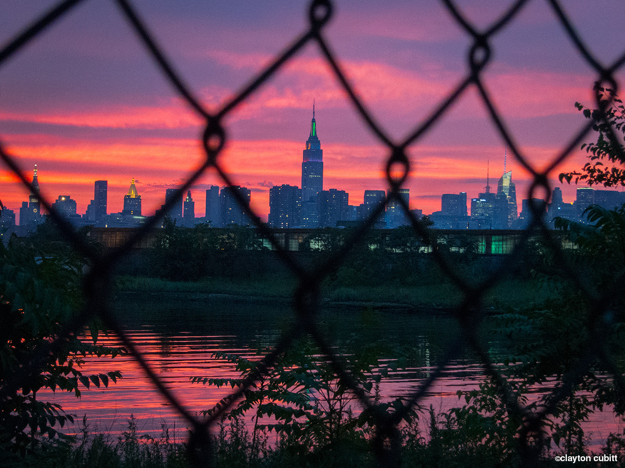 Sunset and Empire State Building through chain link, Brooklyn  (0672)