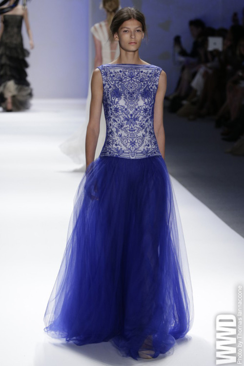 Tadashi Shoji RTW Spring 2013 Nomads and peasants never looked so good. In the lyrical hands of Tadashi Shoji, sheaths and circle-skirted dresses were rendered in nude and jewel-toned bands of vintage Venetian lace.  For More See all of WWD.com's RTW Spring 2013 Runway Coverage