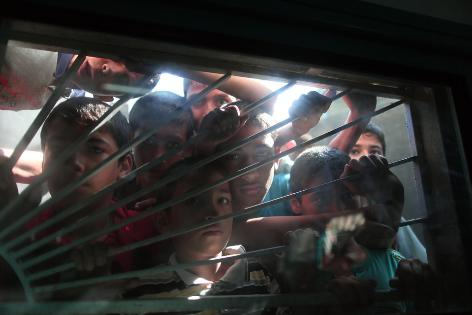 Palestinian children looked through the window of a hospital in Beit Hanoun at the bodies of three Palestinians who were killed when Israel shelled the northern Gaza Strip on Thursday. Xinhua/Zuma Press