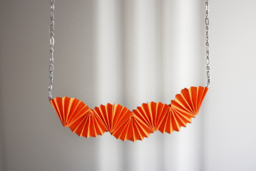 rainbowsandunicornscrafts:  DIY Folded Paper Necklace Tutorial from How About Orange here. This is something older kids can do and if it's destroyed or lost you won't be upset because it was so cheap to make.  Truebluemeandyou: This would be pretty with natural speckled rice paper or marbleized paper.