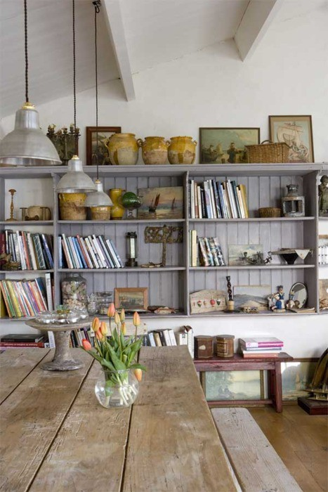 beams . mounted grey shelving with nice collection . great table