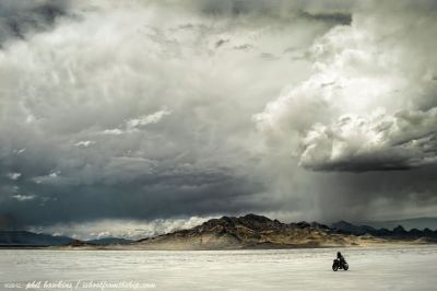 Bonneville Salt Flats… BUB motorcycle speed trials 2012. Photo by Phil Hawkins. I heard tell of being on the salt flats during this rain storm. It came out of no where- and at one end of the raceway you could see the clouds coming for you. Like they were hot on your tail, faster and faster. Riding away as quickly as you could, they'd be nipping at your heels… and then they'd catch you. Dumping rain… more than anyone had before experienced in the prior nine years of BUB.