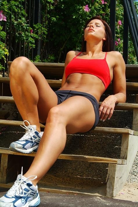 femalebodybuilding:  Tight and healthy body after an afternoon jog in the neighborhood. She relaxes on the stairs as a cool breeze brushes over her sweaty body.