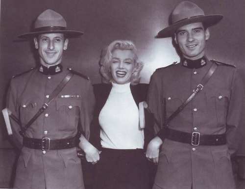 dailymarilynmonroe:  1953: Marilyn Monroe posing happily with soldiers before going to film for her movie River of No Return.