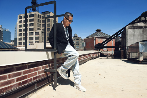 DESIGNER PHILLIP LIM TAKING IT EASY ON HIS ROOF. NEW YORK. JUNE 2012 Photo: Dylan Don