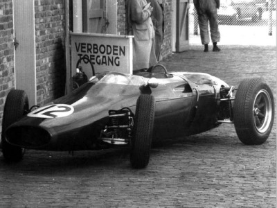 no entry …John Surtees' Cooper-Climax T53 parked in the paddock at Zandvoort, 1961 Dutch Grand Prix