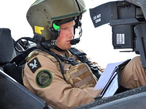 Prince Harry returns to Afghanistan to pilot attack helicopters Prince Harry has flown into Afghanistan to begin a 4-month tour of duty with the British army, where he will command one of the UK's Apache attack helicopters, The Guardian reports.Photo: Prince Harry, or Captain Wales as he is known in the military, prepares his Apache helicopter to go out on a mission during his training in the U.S. earlier this year. (Sgt Russ Nolan Rlc / MoD)