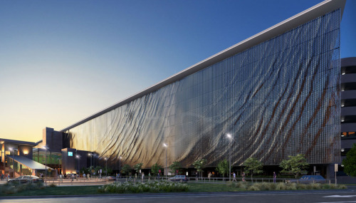 brisbane airport kinetic parking garage facade by ned kahn + UAP brisbane airport kinetic parking garage facade by ned kahn, hassell architecture and UAP images © UAPamerican artist ned kahn, has collaborated with hassell architecture, UAP and the brisbane airport corporation to create an eight-storey,  five-thousand square meter kinetic façade for the car park of brisbane's domestic terminal. viewed from the exterior, the parkade's  entire exterior face will appear to ripple fluidly as the wind activates 118,000 suspended aluminium panels. as it responds to the  ever-changing patterns of the wind, the elevation will create a direct interface between the installation and its natural environment.  as a site-specific reference to the city's most iconic natural feature, the feature is elaborated with fluttering lines from the surface  of the brisbane river. inside the car park, intricate patterns of light and shadows are projected onto the walls and floor as sunlight  passes through the external panelling system. this provides practical environmental benefits such as shade and natural ventilation  for the interior space of the lot.  via:dddigitaldesign