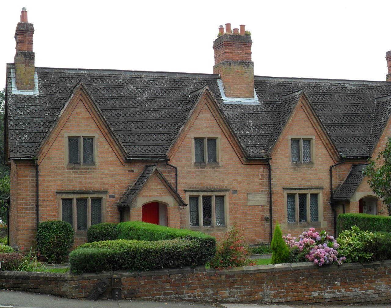 Lovely red brick terrace of cottages with gables, Bramcote, Nottingham.