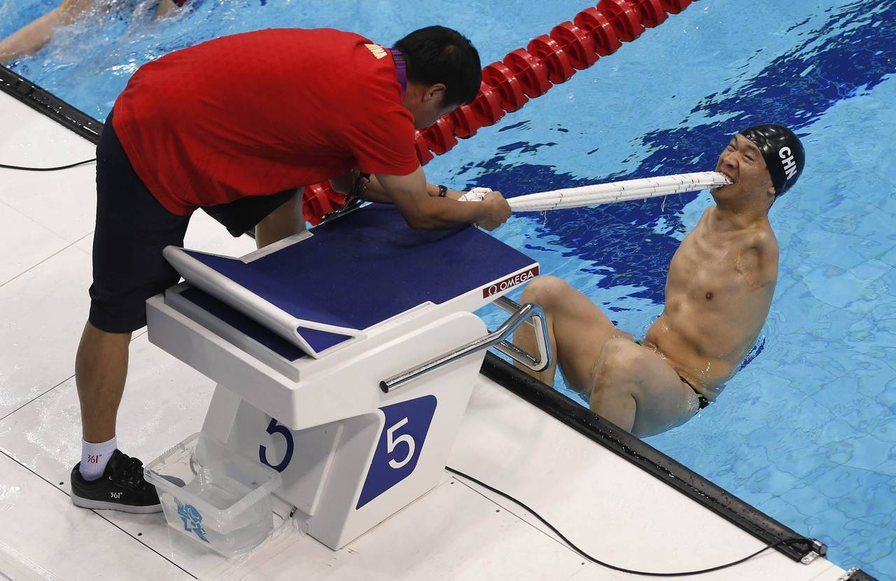 Another amazing photo from the Paralympics: China's He Junquan bites on a towel to aid his start in the men's 50m Backstroke S5 race at the Aquatics Centre in the Olympic Park. The S5 category is for swimmers with major limb loss of two limbs or with full use of their arms and hands but no trunk or leg muscles; swimmers with moderate coordination problems.