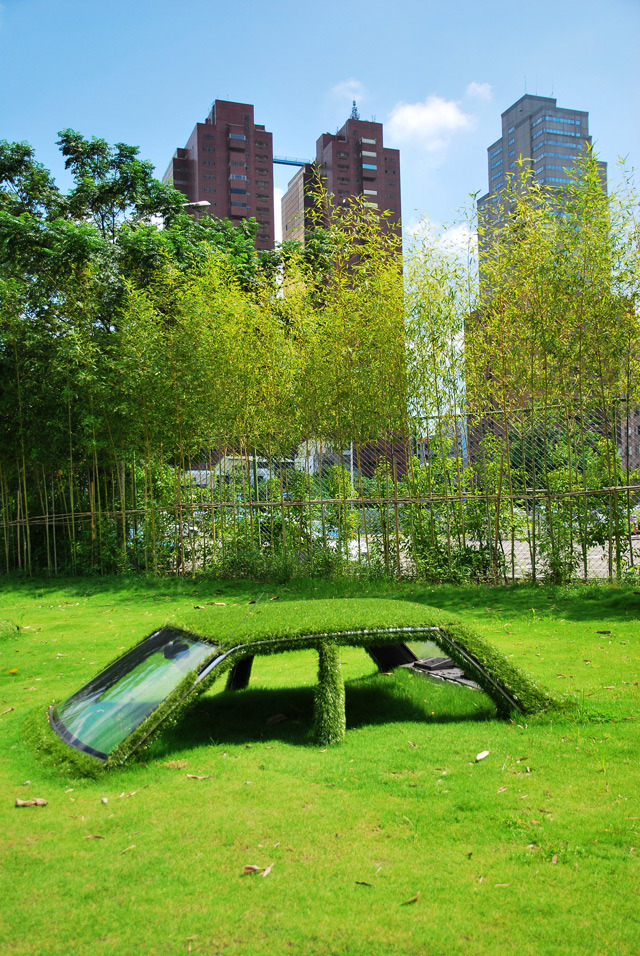 Buried vehicles being reclaimed by nature at CMP Block in Taiwan.